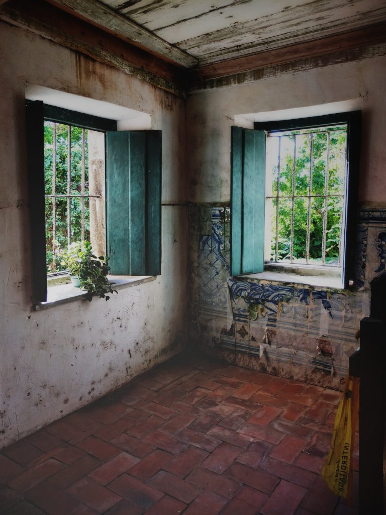 Two old windows in a home.